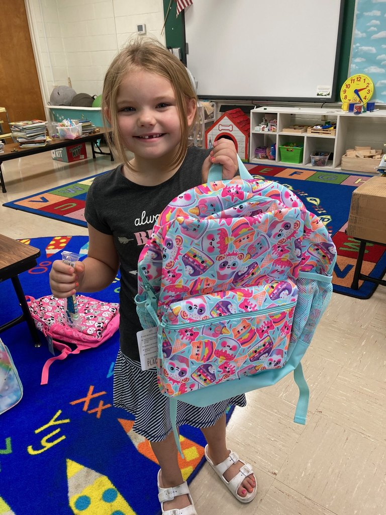 Adyson receives her backpack for completing Summer School!