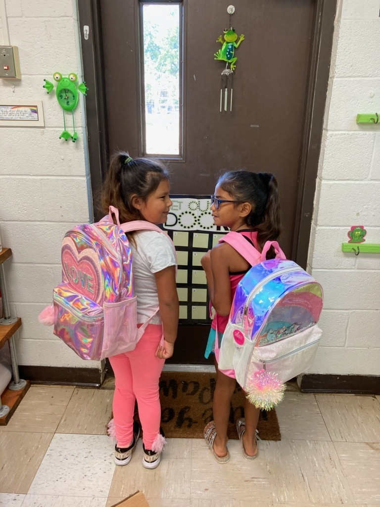 Neyli and Vanesa receive their backpacks for completing Summer School!